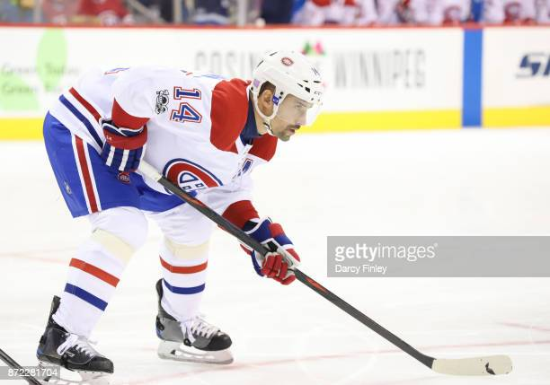 Tomas Plekanec of the Montreal Canadiens gets set for a first period faceoff against the Winnipeg Jets at the Bell MTS Place on November 4 2017 in...
