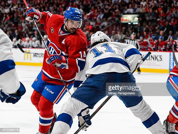 Tomas Plekanec of the Montreal Canadiens gets tangled with Brian Boyle of the Tampa Bay Lightning in Game Two of the Eastern Conference Semifinals...