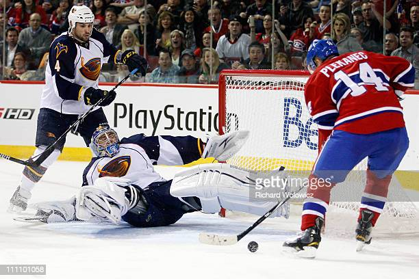 Tomas Plekanec of the Montreal Canadiens gets the rebounding puck in front of Ondrej Pavelec of the Atlanta Thrashers during the NHL game at the Bell...
