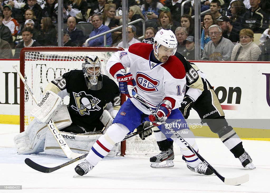 Tomas Plekanec #14 of the Montreal Canadiens handles the puck against Brandon Sutter #16 of the Pittsburgh Penguins during the game at Consol Energy Center on March 26, 2013 in Pittsburgh, Pennsylvania.