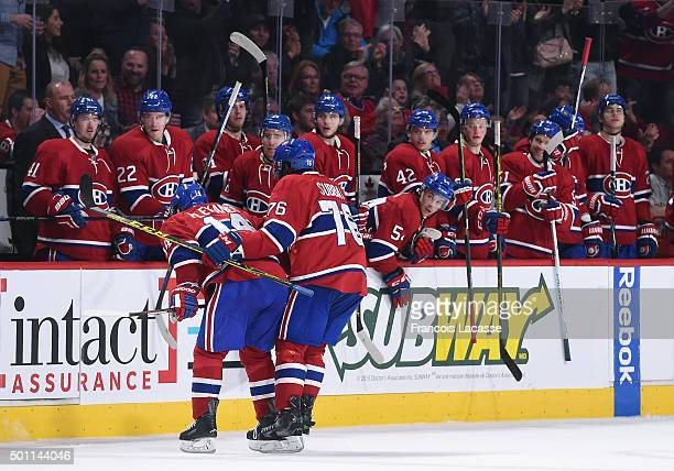 Tomas Plekanec of the Montreal Canadiens is congratulated at the bench during the NHL game against Ottawa Senators at the Bell Centre on December 12...