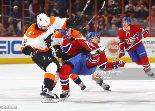 Tomas Plekanec of the Montreal Canadiens is hit by Radko Gudas of the Philadelphia Flyers during the first period at the Wells Fargo Center on...