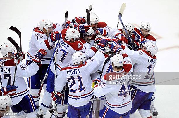 Tomas Plekanec of the Montreal Canadiens is mobbed by teammates after scoring the gamewinning goal in overtime against the Washington Capitals in...