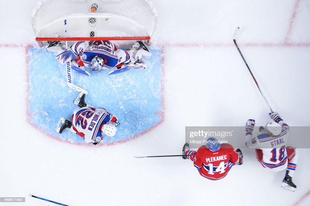 Tomas Plekanec #14 of the Montreal Canadiens scores late in the third period on goaltender Henrik Lundqvist #30 of the New York Rangers in Game Two of the Eastern Conference First Round during the 2017 NHL Stanley Cup Playoffs at the Bell Centre on April 14, 2017 in Montreal, Quebec, Canada. The Montreal Canadiens defeated the New York Rangers 4-3 in overtime.