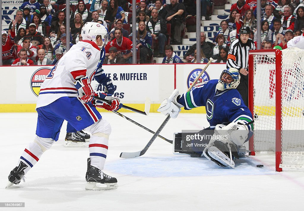 Tomas Plekanec of the Montreal Canadiens scores on Roberto Luongo of the Vancouver Canucks during their NHL game at Rogers Arena on October 12 2013...