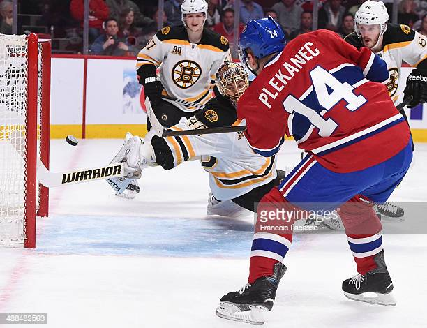Tomas Plekanec of the Montreal Canadiens scores the first goal on goaltender Tuukka Rask of the Boston Bruins in the first period in Game Three of...