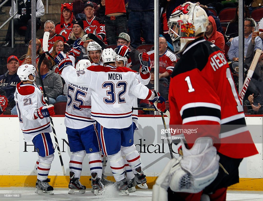Tomas Plekanec #14 of the Montreal Canadiens scores the game winning goal at 6:49 of the third period against Johan Hedberg #1 of the New Jersey Devils at the Prudential Center on March 16, 2013 in Newark, New Jersey. The Canadiens defeated the Devils 2-1.