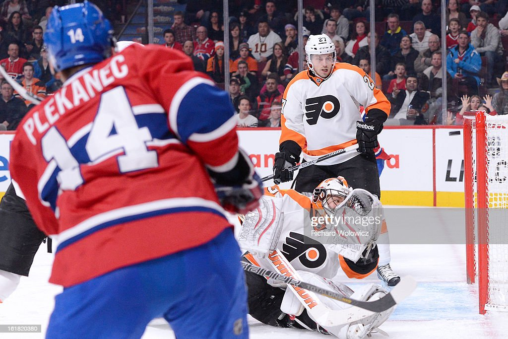 Tomas Plekanec of the Montreal Canadiens shoots the puck past Brian Boucher of the Philadelphia Flyers to score the Canadiens third goal during the...