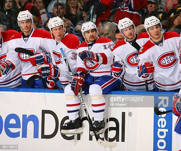 Tomas Plekanec of the Montreal Canadiens sits on the boards to join teammates celebrating a goal against the Buffalo Sabres on December 3 2009 at...