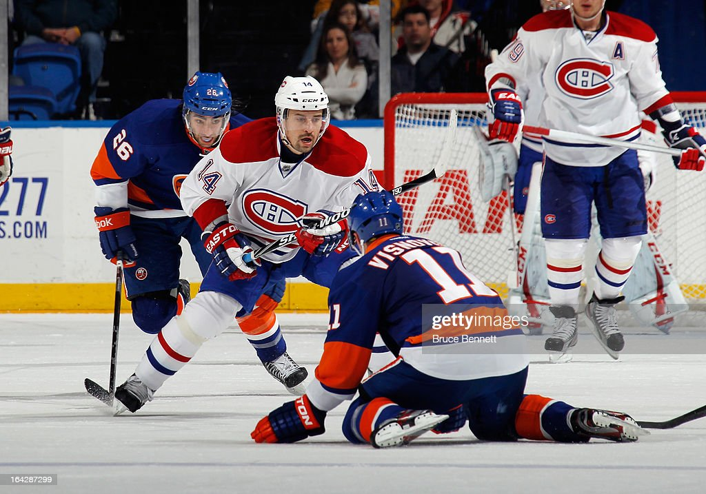 <a gi-track='captionPersonalityLinkClicked' href=/galleries/search?phrase=Tomas+Plekanec&family=editorial&specificpeople=620244 ng-click='$event.stopPropagation()'>Tomas Plekanec</a> #14 of the Montreal Canadiens skates against the New York Islanders at the Nassau Veterans Memorial Coliseum on March 21, 2013 in Uniondale, New York.The Canadiens defeated the Islanders 5-2.