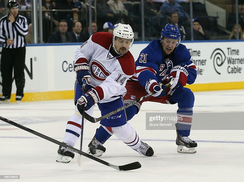<a gi-track='captionPersonalityLinkClicked' href=/galleries/search?phrase=Tomas+Plekanec&family=editorial&specificpeople=620244 ng-click='$event.stopPropagation()'>Tomas Plekanec</a> #14 of the Montreal Canadiens skates against the New York Rangers at Madison Square Garden on October 28, 2013 in New York City. The Canadiens shutout the Rangers 2-0.