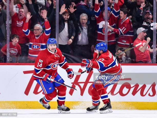 Tomas Plekanec of the Montreal Canadiens skates as he celebrates his goal late in the third period with teammate Alex Galchenyuk against the New York...