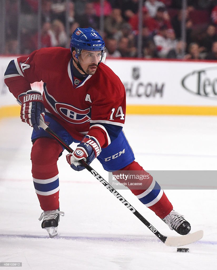 Tomas Plekanec of the Montreal Canadiens skates with the puck against of the Detroit Red Wings in the NHL game at the Bell Centre on October 21 2014...