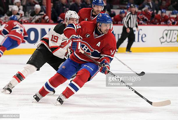 Tomas Plekanec of the Montreal Canadiens skates with the puck against the New Jersey Devils in the NHL game at the Bell Centre on February 7 2015 in...