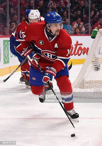 Tomas Plekanec of the Montreal Canadiens skates with the puck against the Florida Panthers in the NHL game at the Bell Centre on February 19 2015 in...