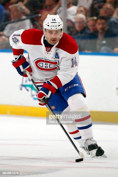 Tomas Plekanec of the Montreal Canadiens skates with the puck against the Florida Panthers at the BBT Center on April 3 2017 in Sunrise Florida