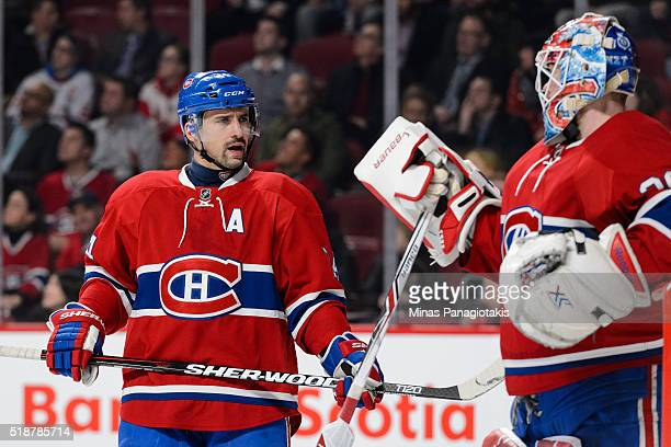 Tomas Plekanec of the Montreal Canadiens speaks with goaltender Mike Condon during the NHL game against the Detroit Red Wings at the Bell Centre on...