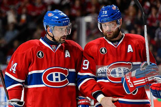 Tomas Plekanec of the Montreal Canadiens speaks with teammate Andrei Markov in Game One of the Eastern Conference Semifinals against the Tampa Bay...