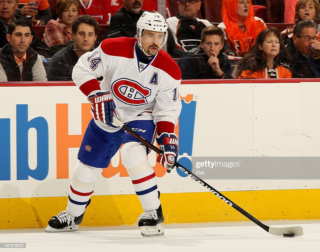 Tomas Plekanec of the Montreal Canadiens takes the puck in the first period against the Philadelphia Flyers on October 11 2014 at the Wells Fargo...
