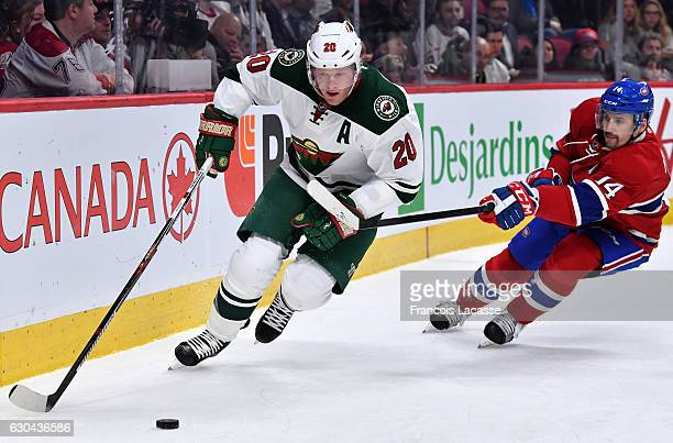 Tomas Plekanec of the Montreal Canadiens tries to slow down Ryan Suter of the Minnesota Wild in the NHL game at the Bell Centre on December 22 2016...