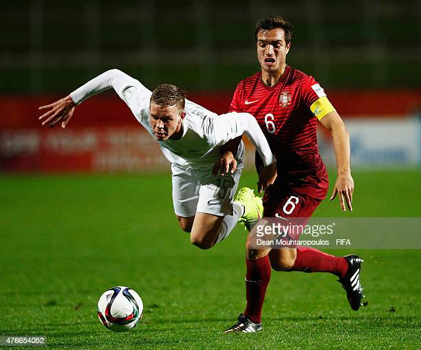 Tomas Podstawski of Portugal and Monty Patterson of New Zealand battle for the ball during the FIFA U20 World Cup New Zealand 2015 Round of 16 match...