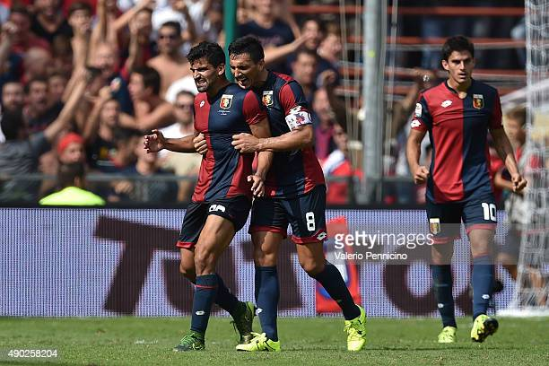 Tomas Rincon and Nicolas Burdisso of Genoa CFC celebrate victory at the end of the Serie A match between Genoa CFC and AC Milan at Stadio Luigi...