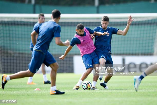 Tomas Rincon and Rodrigo Bentancur of Juventus during a training session on July 14 2017 in Vinovo Italy
