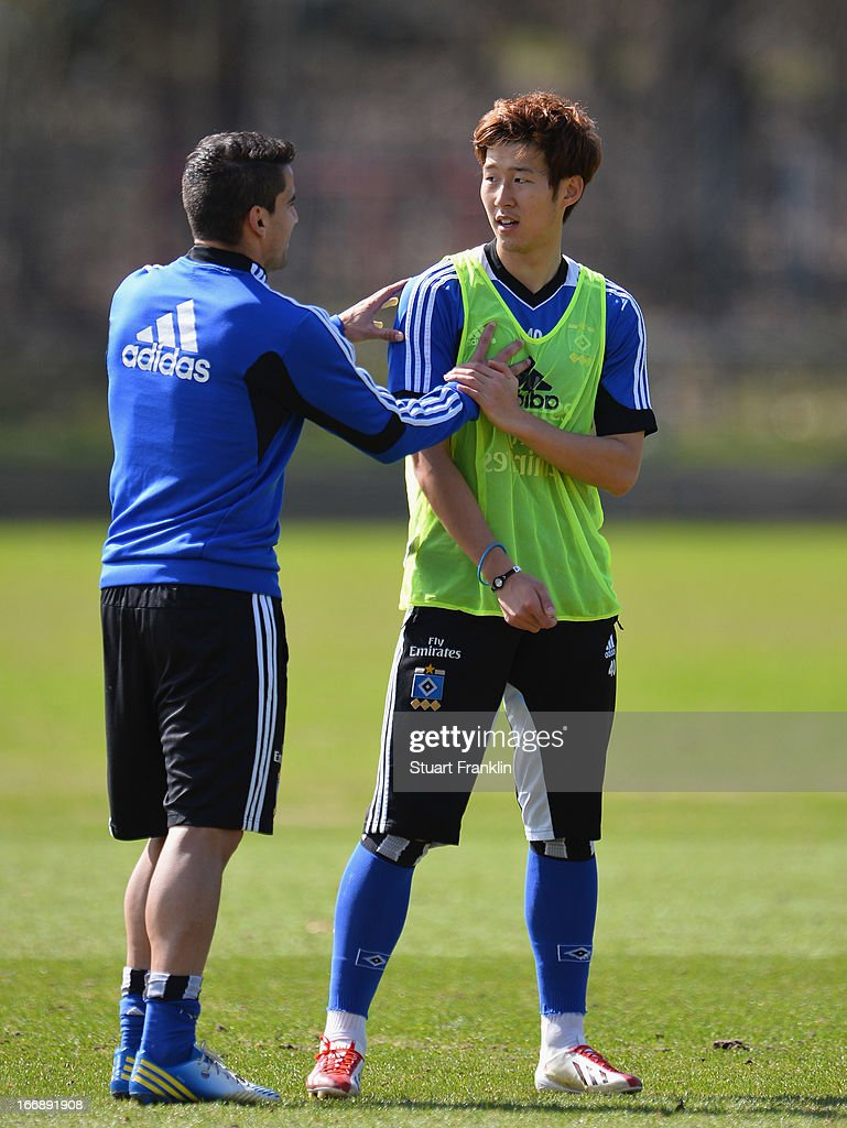 Tomas Rincon holds onto Heung Min Son of Hamburg during a training session of Hamburger SV on April 18, 2013 in Hamburg, Germany.