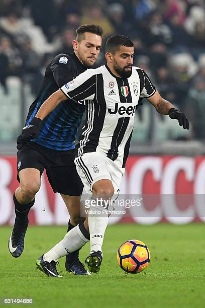 Tomas Rincon of FC Juventus is challenged by Rafael Toloi of Atalanta BC during the TIM Cup match between FC Juventus and Atalanta BC at Juventus...