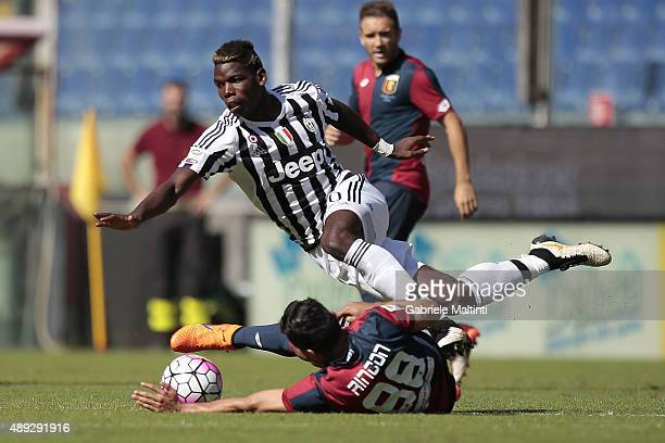 Tomas Rincon of Genoa CFC battles for the ball with Paul Pogba of Juventus FC during the Serie A match between Genoa CFC and Juventus FC at Stadio...