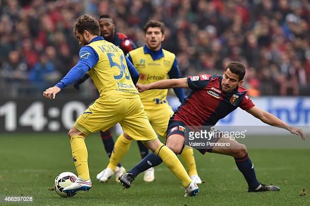 Tomas Rincon of Genoa CFC competes with Perparim Hetemaj of AC Chievo Verona during the Serie A match between Genoa CFC and AC Chievo Verona at...