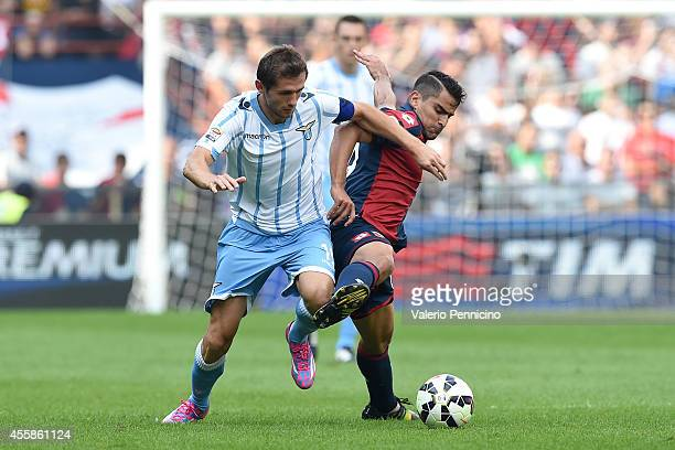 Tomas Rincon of Genoa CFC competes with Senad Lulic of SS Lazio during the Serie A match between Genoa CFC and SS Lazio at Stadio Stadio Luigi...