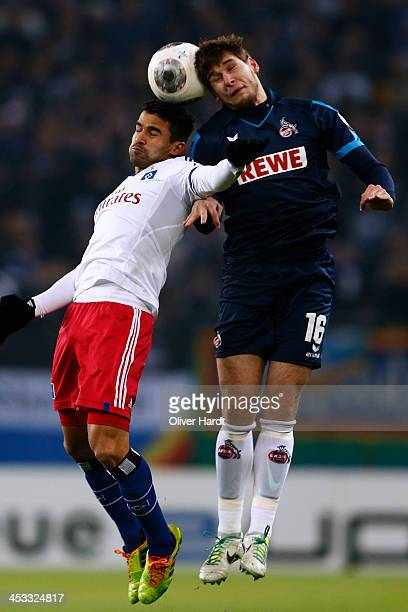 Tomas Rincon of Hamburg and Patrick Helmes of Koeln compete for the ball during the DFP Cup round of 16 at Imtech Arena on December 3 2013 in Hamburg...