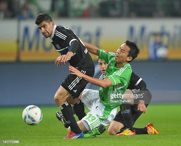 Tomas Rincon of Hamburg challenges Makato Hasebe of Wolfsburg during the Bundesliga match between VfL Wolfsburg and Hamburger SV at Volkswagen Arena...