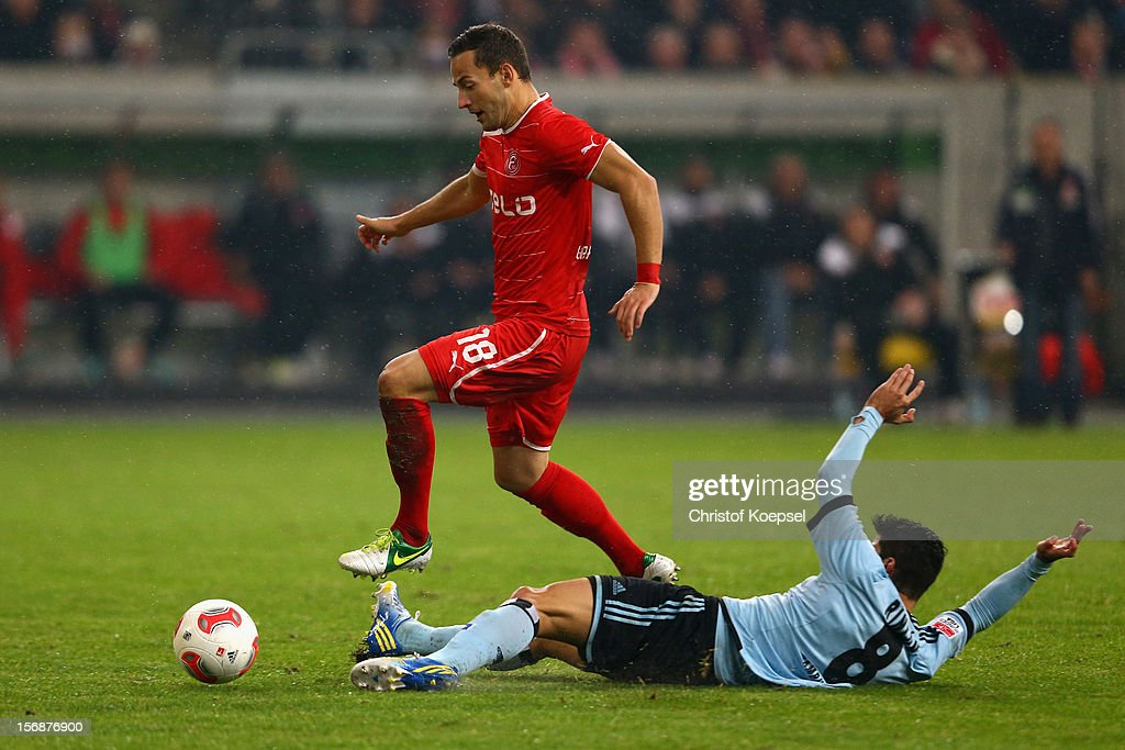 Tomas Rincon of Hamburg (R) challenges Roland Garbuschewski of Duesseldorf during the Bundesliga match between Fortuna Duesseldorf and Hamburger SV at Esprit-Arena on November 23, 2012 in Duesseldorf, Germany.
