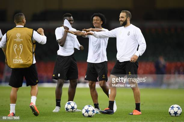 Tomas Rincon of Juventus and Gonzalo Higuain of Juventus share a joke during a Juventus training session prior to the UEFA Champions League Final...
