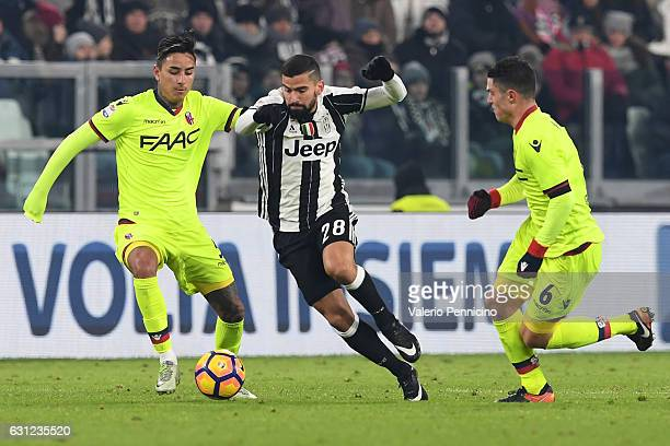 Tomas Rincon of Juventus FC in action against ErickÊPulgar and Federico Viviani of Bologna FC during the Serie A match between Juventus FC and...