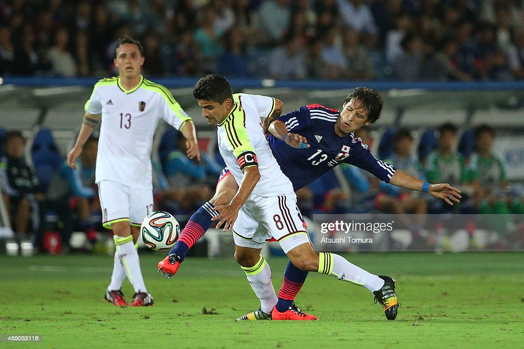 Tomas Rincon of Venezuela and Hajime Hosogai of Japan compete for the ball during the KIRIN CHALLENGE CUP 2014 international friendly match between...