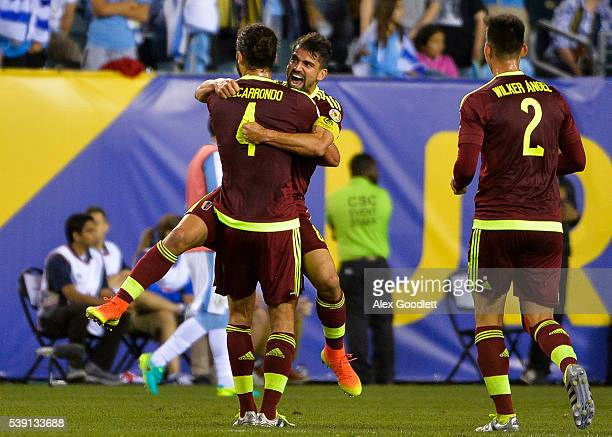 Tomas Rincon of Venezuela celebrates with teammate Oswaldo Vizcarrondo after winning a group C match between Uruguay and Venezuela at Lincoln...