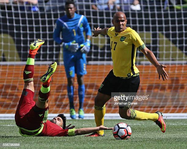 Tomas Rincon of Venezuela lands on his back after having the ball stolen by Rodolph Austin of Jamaica during a match in the 2016 Copa America...