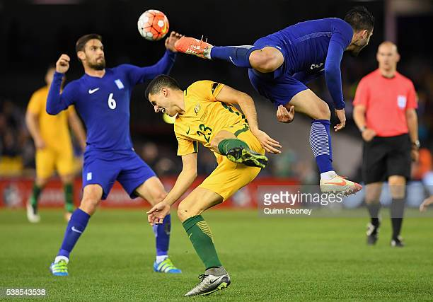 Tomas Rogic of Australia and Georgios Tzavellas of Greece collide whilst going for the ball during the International Friendly match between the...