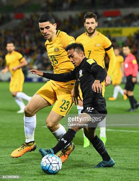 Tomas Rogic of Australia and Teerasil Dangda of Thailand compete for the ball during the 2018 FIFA World Cup Qualifier match between the Australian...