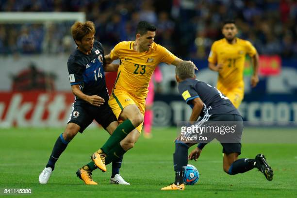 Tomas Rogic of Australia controls the ball under pressure of Takashi Inui and Yosuke Ideguchi of Japan during the FIFA World Cup Qualifier match...