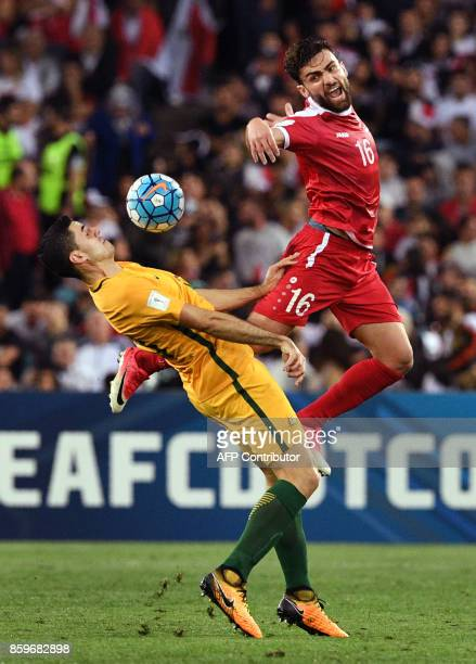 Tomas Rogic of Australia fights for the ball with Hamid Mido of Syria during their 2018 World Cup football qualifying match played in Sydney on...