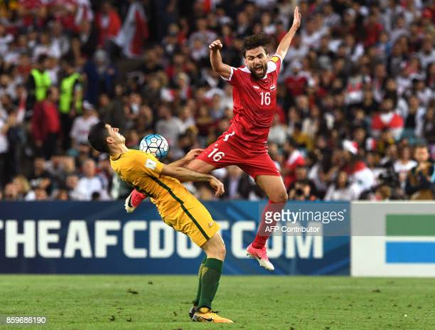 TOPSHOT Tomas Rogic of Australia fights for the ball with Hamid Mido of Syria during their 2018 World Cup football qualifying match played in Sydney...