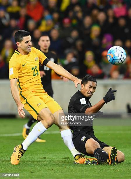 Tomas Rogic of Australia is tackled by Adison Promrak of Thailand during the 2018 FIFA World Cup Qualifier match between the Australian Socceroos and...
