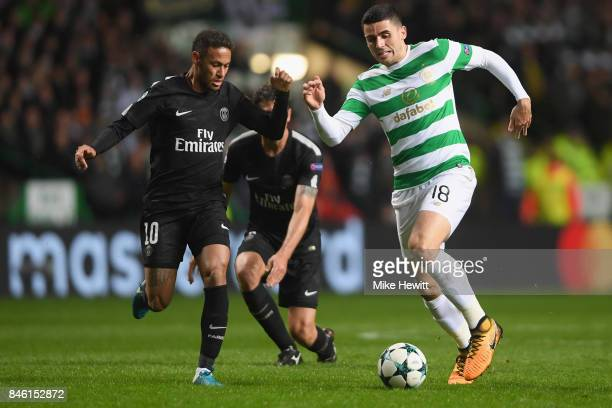 Tomas Rogic of Celtic attempts to get past Neymar of PSG during the UEFA Champions League Group B match between Celtic and Paris Saint Germain at...