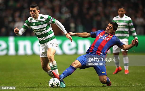 Tomas Rogic of Celtic is tackled by Luis Suarez of Barcelona during the UEFA Champions League Group C match between Celtic FC and FC Barcelona at...