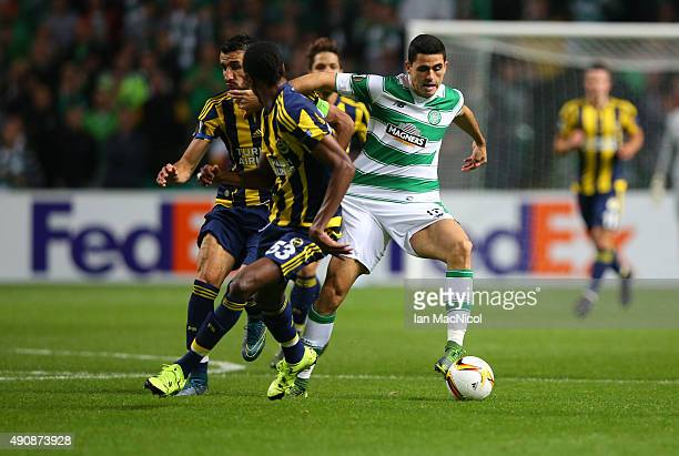 Tomas Rogic of Celtic vies with Mehmet Topal of Fenerbahce and Abdoulaye Ba of Fenerbahe during the UEFA Europa League match between Celtic FC and...