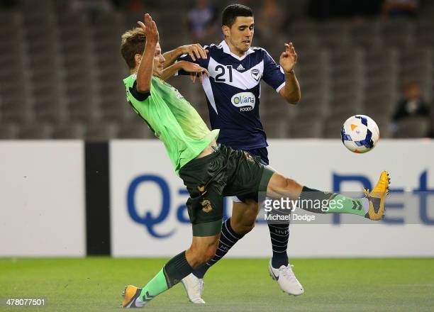 Tomas Rogic of the Victory and Alex Wilkinson of Joenbuk contest for the ball during the AFC Asian Champions League match between the Melbourne...